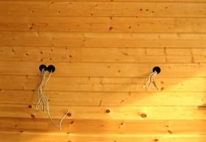 Будущие розетки в деревянной стене