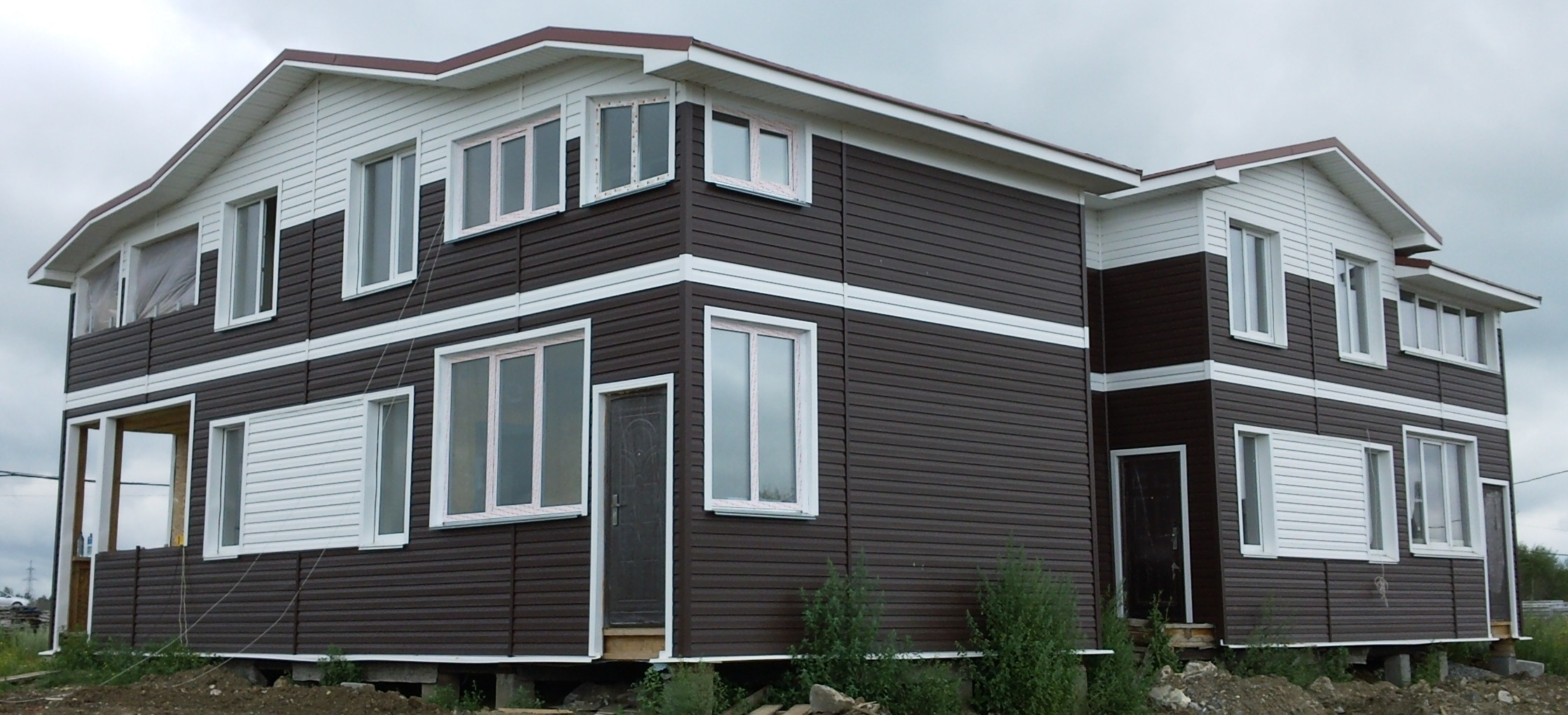 Фасад дома, оформленный металлосайдингом